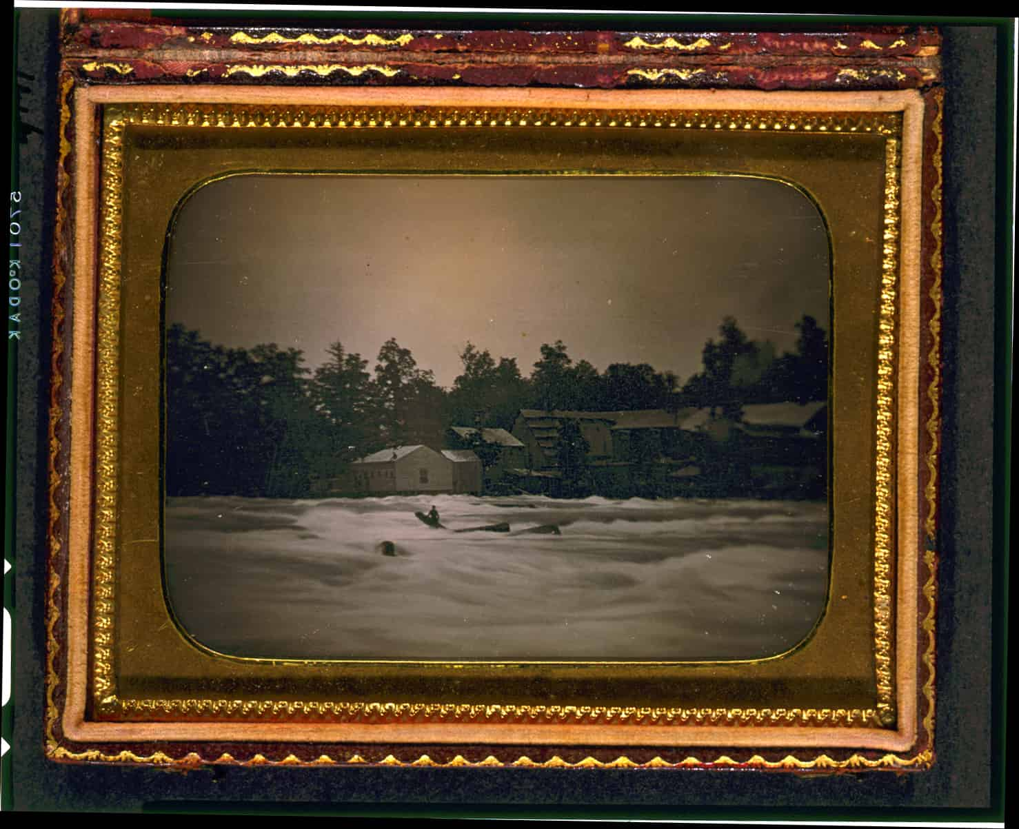 Joseph Avery stranded on rocks in the Niagara River. Three men boating in the Niagara River were overwhelmed by the river's strong current, lost control of their boat, and crashed into a rock. The current carried two men immediately over the Falls to their deaths. The daguerreotype shows the third man, stranded on a log which had jammed between two rocks. He weathered the current for eighteen hours before succumbing to the river. The image is an early example of a news photograph. Platt D. Babbitt, 1853